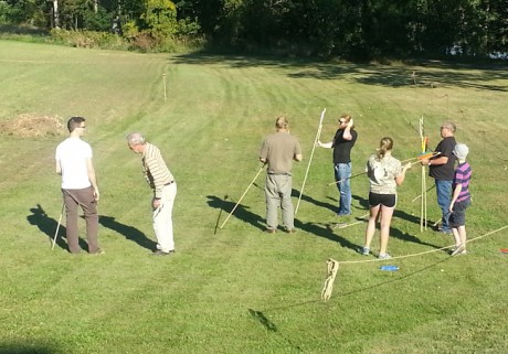 Workshop Participants try out atlatls