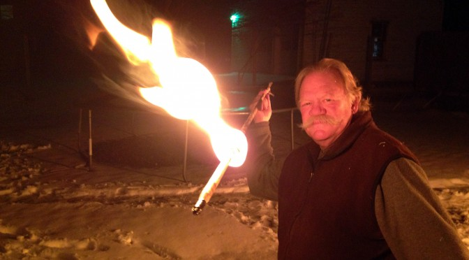 Throwing a flaming atlatl dart for Winter Solstice