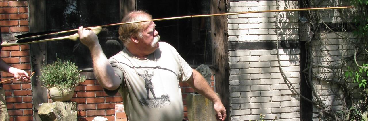 Thunderbird Atlatl founder Bob Berg throwing a dart.