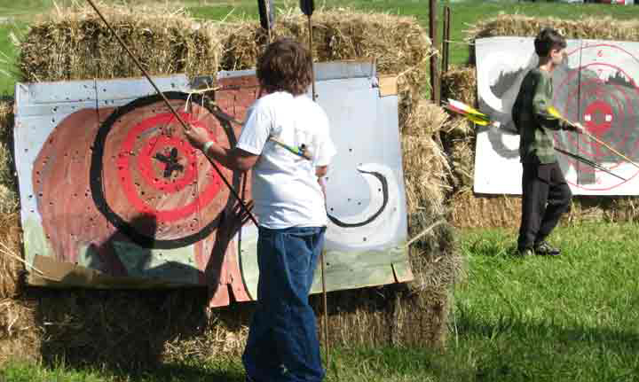 Participants remove darts from targets.