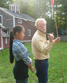Showing how to cast an atlatl