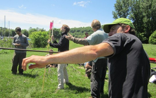 Participants at Primitive Pursuits in Ithaca having atlatl fun with a finished Catatonk Hunter Atlatl and an expedient atlatl.  Bob Berg of Thunderbird Atlatl (center) leads the fun.