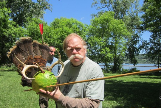 Thunderbird Atlatl Bob Berg shows how an atlatl and dart can handle predators. The Primitive Pursuit class helped capture this predator.